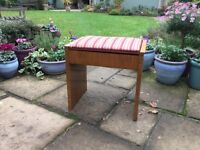 A lovely Piano Stool ....with an upholstered , tip up seat
