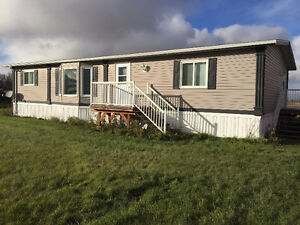 Double wide 1352 sq ft mobile home to be moved.