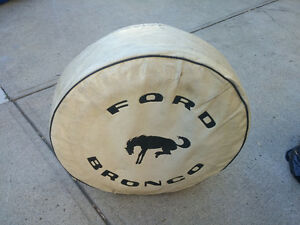Ford bronco. Tire and cover mint condition