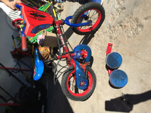 Boys Spiderman bike with training wheels.