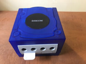 Clear purple game cube  with controller and chords