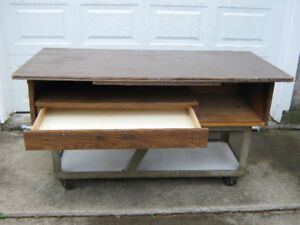 Work table with metal base and casters