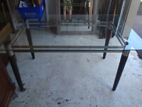 solid glass dining table with wood legs, rectangle shape