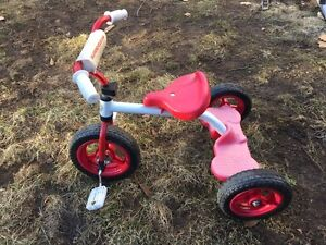 """Supercycle kid 10""""-deluxe tricycle."""