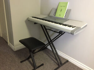 Casio Keyboard with stand and bench