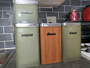 Lot of four vintage tin canisters