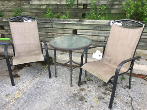 Bistro patio set. Excellent condition. Round glass table two  ch