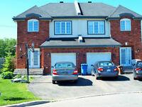 West Island (Kirkland) Spacious semi-detached house for sale.