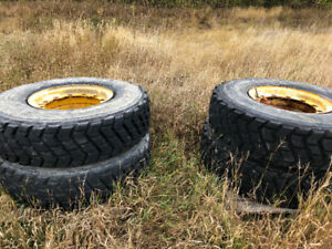 (4) 14-24 radio grader tires 90% on three piece rims