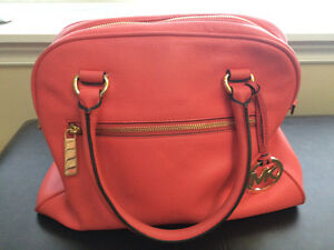 Michael Kors Genuine Leather Purse willing to trade see ad