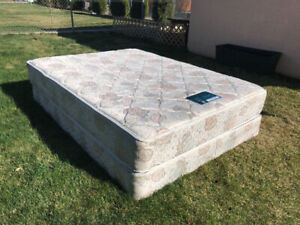 Queen size bed with box spring.