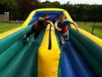 Bungee run in very good condition. Other bouncy castles also available.