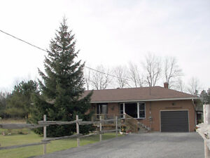 PRICE REDUCED- FULLY UPDATED BRICK BUNGALOW - MUST SEE INSIDE !