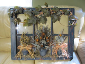 Wall art made on antique window.