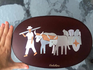 Artwork from Costa Rica - brass on wood