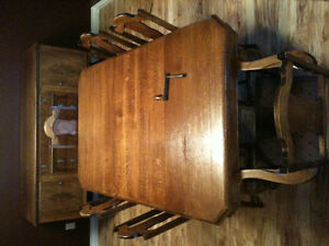 Antique dining room table, chairs, and sideboard