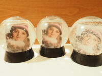 3 personalized snow globes.