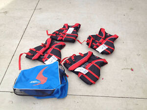 4 Brand New life Jackets with storage bag