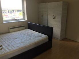 Good condition mattress and leather bed frame