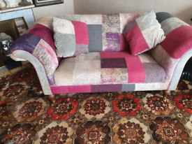 Matching sofas cushions and footstall