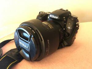 nikon d7000 with 18-200mm lens + good accessories.