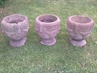 Three matching stone planters