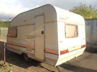 For sale a 2 berth caravan with utillities needs some work drive it away