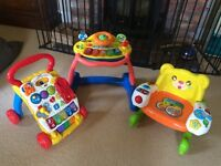 V tech baby walkers X 2 and a musical chair