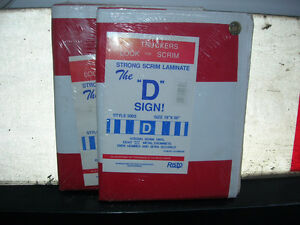 "Vinyl ""D"" Signs, still in packaging"