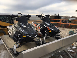 2 Snowmobiles with trailer package
