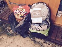 Portable BBQ and a bag of charcoal