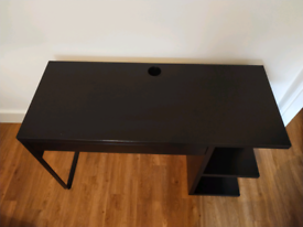 Black IKEA Micke desk with front drawer and side shelving