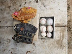 3 base ball gloves bags and a box of balls