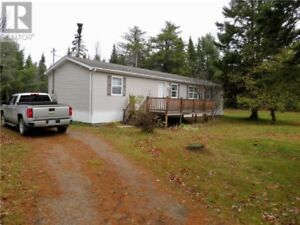 Great 3 bedroom Mini Home on 1.05 acres with a garage/shop!!