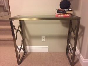 Glass top with brass brushed detailed console table