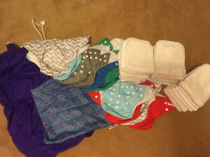 12 cloth diapers, 24 liners, large and small wet bag