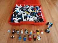 Lego with minifigures in a red Lego case
