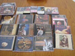 collection of cds and tapes