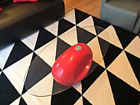 **$300** Sleek oval shaped glass top with high gloss red base