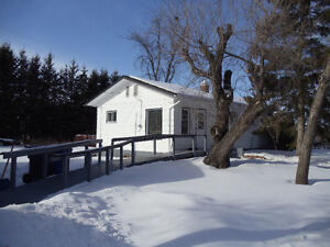 Beautiful Bungalow on 2 lots with Large Garage in Canora, SK