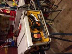 Rigid 10 inch 15 amp compact portable table saw.
