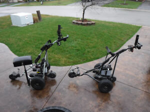 Two Walking Electric Golf Carts