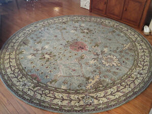 Thick natural wool round area rug