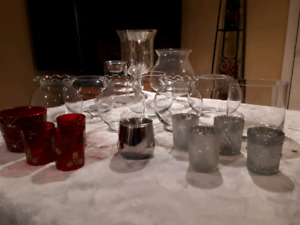 Various different vases and votive candle holders..