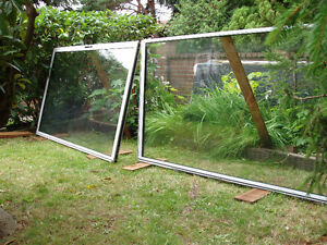 "GLASS-PATIO SLIDING DOORS 47"" X 78"".NEW."