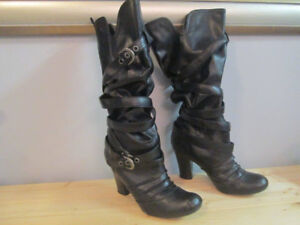 Black leather boots with slouch straps. $10.00