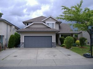 NEW PRICE! West Abby 6 bedroom & 4 bath home with basement suite