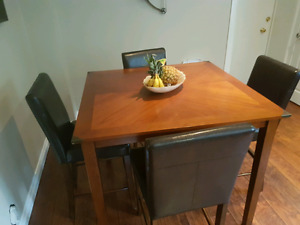 Good condition table and 4 leather chairs$.200