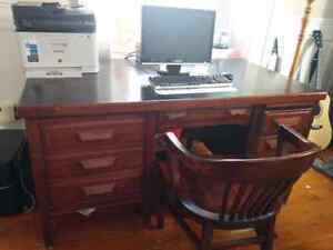 Large solid wood, antique desk with chair