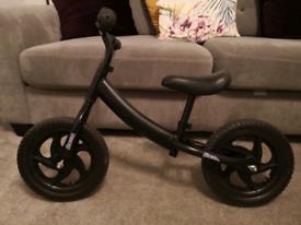"12"" Black Balance bike. Carbon steel frame. Excellent condition."